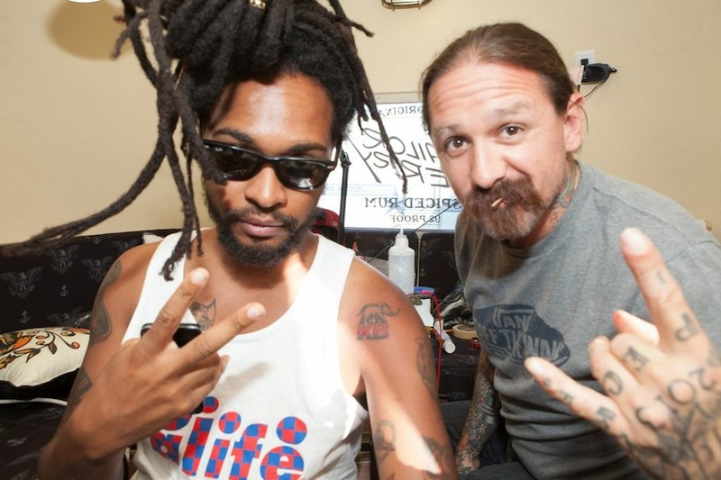 Roofeeo, Drummer from TV on the Radio getting an Oliver Peck tattoo at FYF Fest